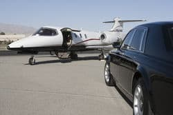 stock photo limousine and private jet on landing strip 119204140
